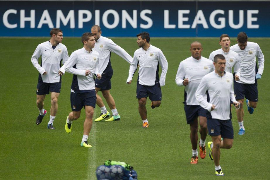 Les joueurs de Manchester City se sont entraînés,... (Photo Jon Super, AP)