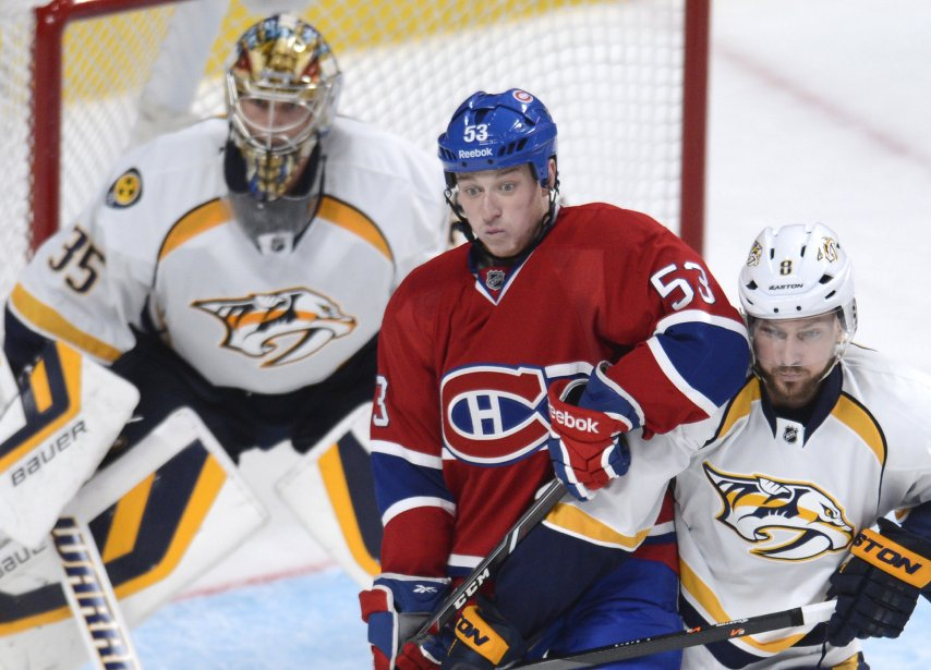 Ryan White, du Canadiens, se bat avec Kevin Klein devant le gardien des Predators Pekka Rinne. (Photo Bernard Brault, La Presse)