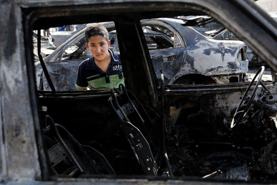 À Bagdad et dans ses environs, neuf voitures... (Photo Karim Kadim, AP)