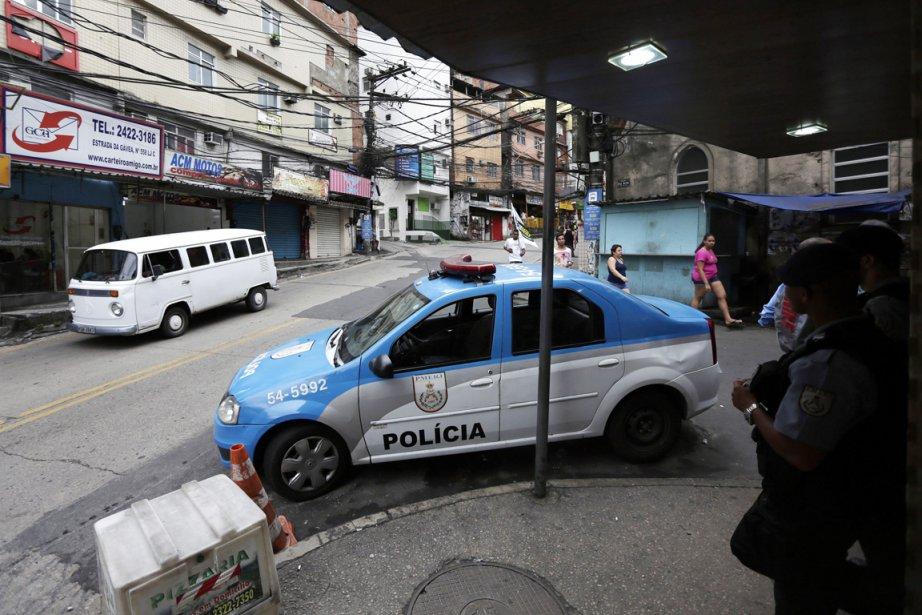 L'épouse du commerçant travaille dans une des Unités... (PHOTO RICARDO MORAES, ARCHIVES REUTERS)