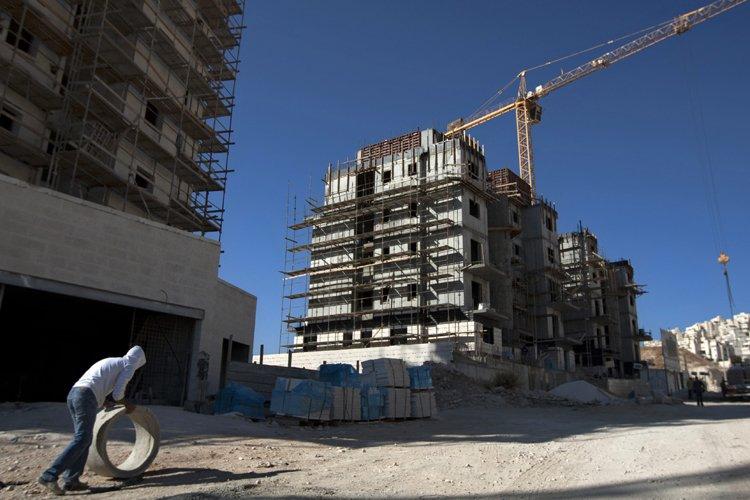 Israël a lancé dimanche des appels d'offre pour... (Photo: AP)