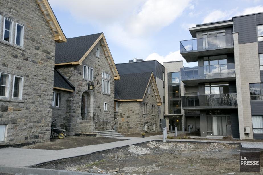 Pour le projet Domaine des Arches, trois maisons en rangée et deux condos ont...