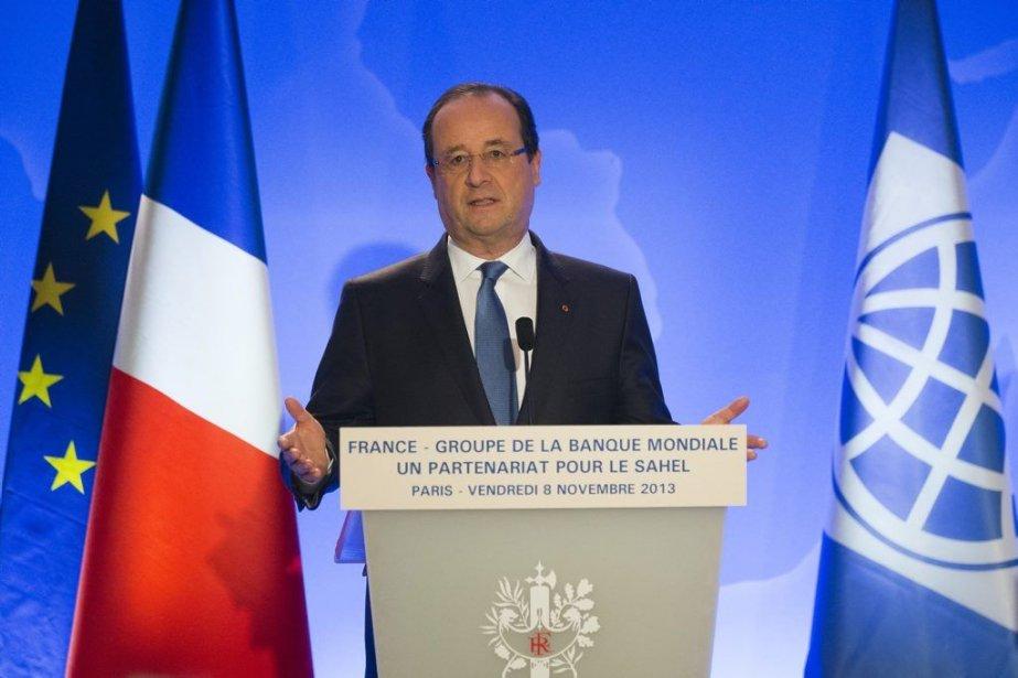 Le président français François Hollande a réagi à... (Photo Michel Euler, AP)