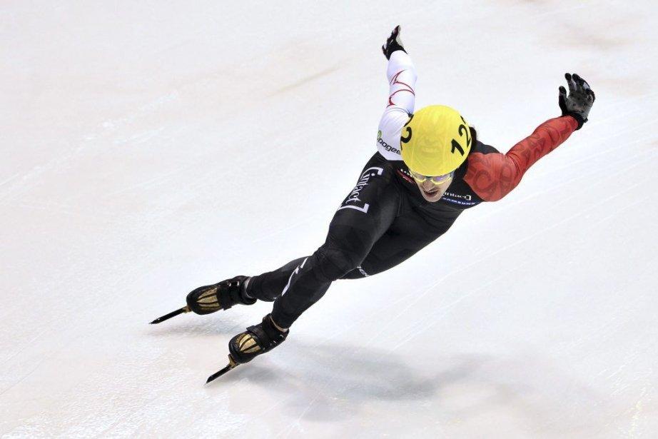 Charles Hamelin a remporté les sept courses auxquelles... (Photo Giuseppe Cacace, AFP)