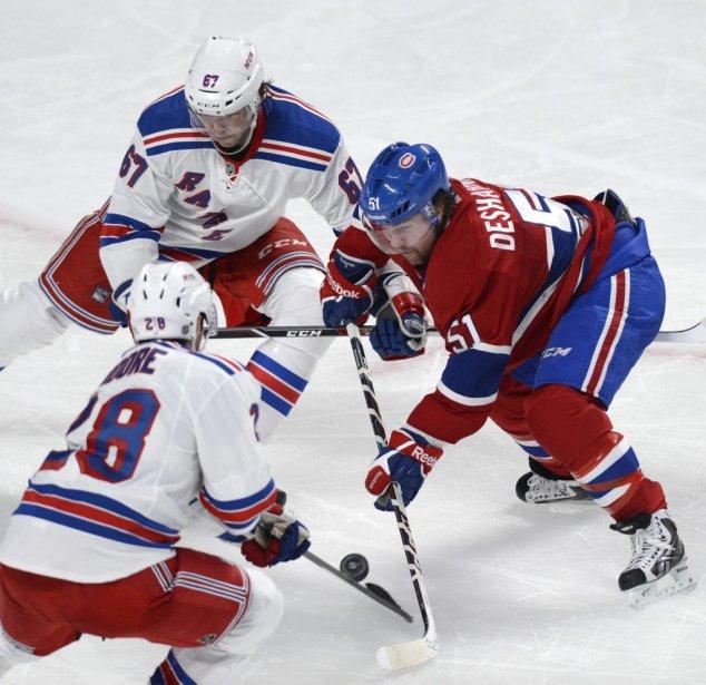 David Desharnais (51) du Canadien face à Benoit Pouliot (67) et Dominic Moore (28) des Rangers lors de la troisième période. (Photo Bernard Brault, La Presse)