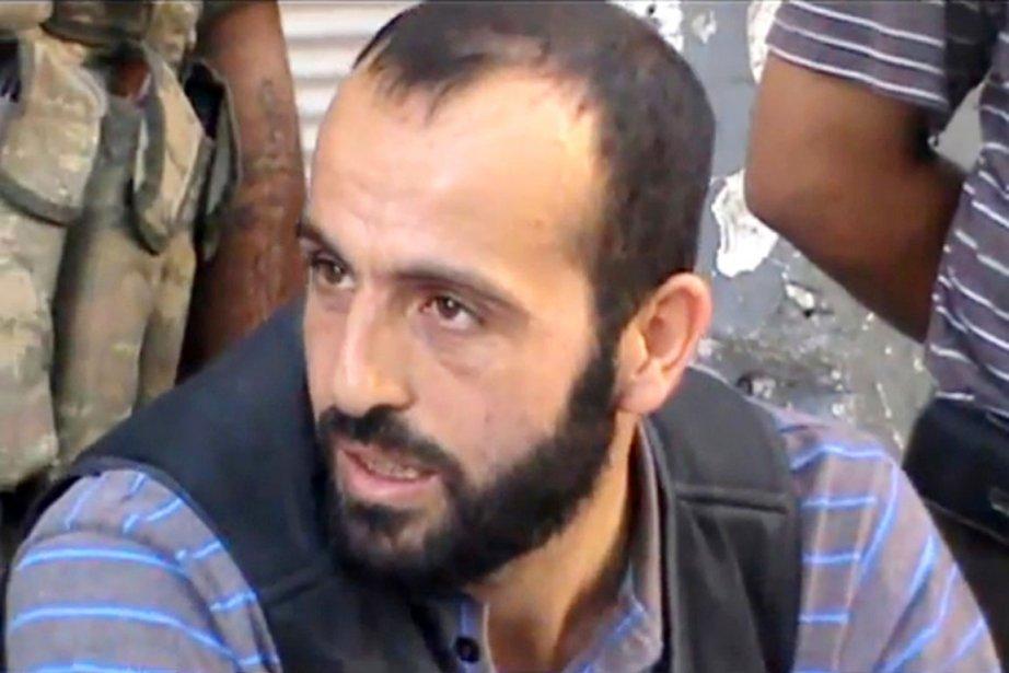 Le dirigeant du groupe Liwa al-Tawhid, Abdel Qader... (PHOTO AFP/YOUTUBE)