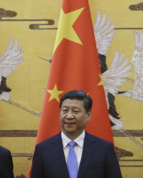 Le président chinois, Xi Jinping, fait face à... (Photo JASON LEE. Agence france-presse)
