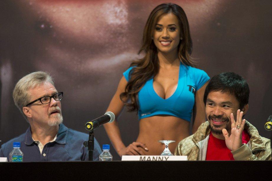 L'entraîneur Freddie Roach et le boxeur Manny Pacquiao.... (Photo Tyrone Siu, Reuters)