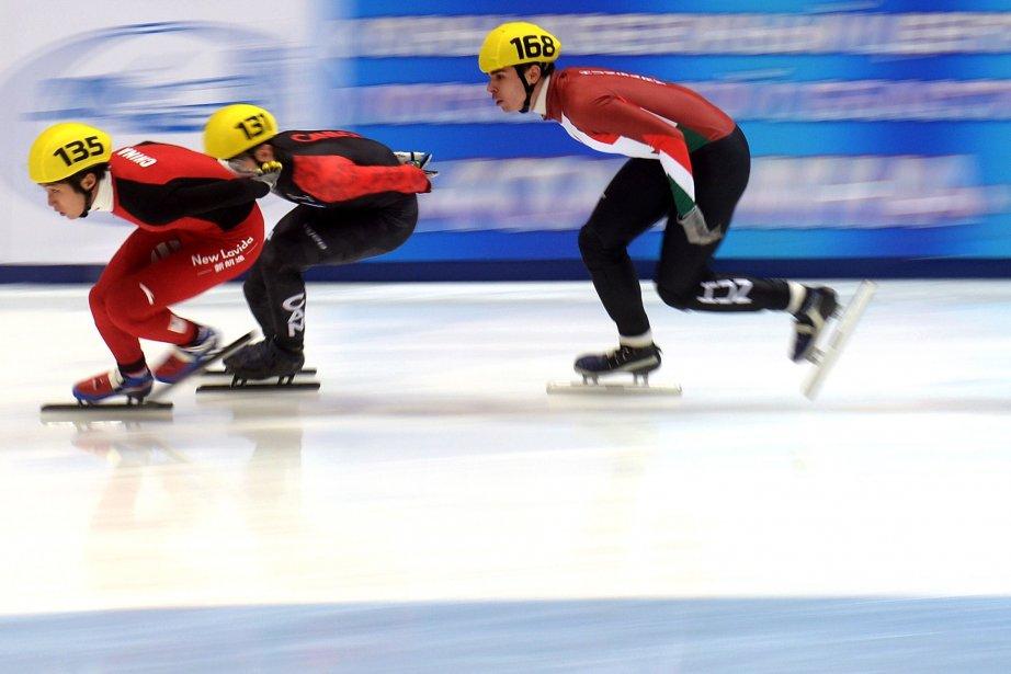 Le Chinois Dequan Chen mène devant le Québécois... (Photo VASILY MAXIMOV, AFP)