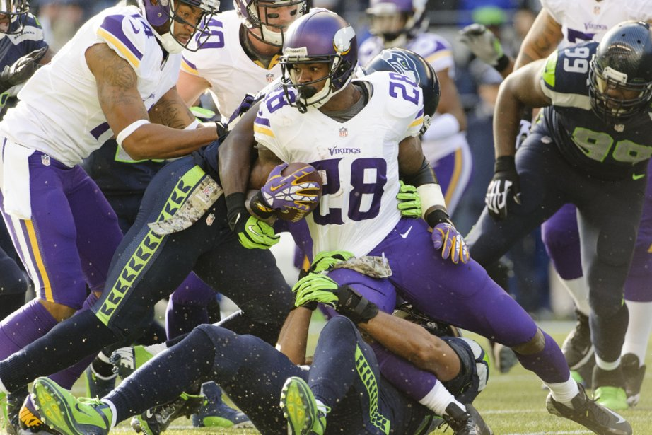 Adrian Peterson... (Photo Steven Bisig, USA Today)