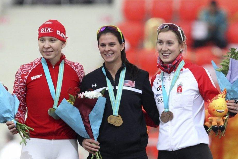 La Canadienne Brittany Schussler à la droite de... (Photo Alexei Filippov, AP)