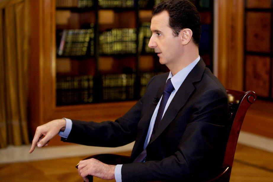 Le président Bachar al-Assad a promulgué mercredi par... (PHOTO AP/SANA)