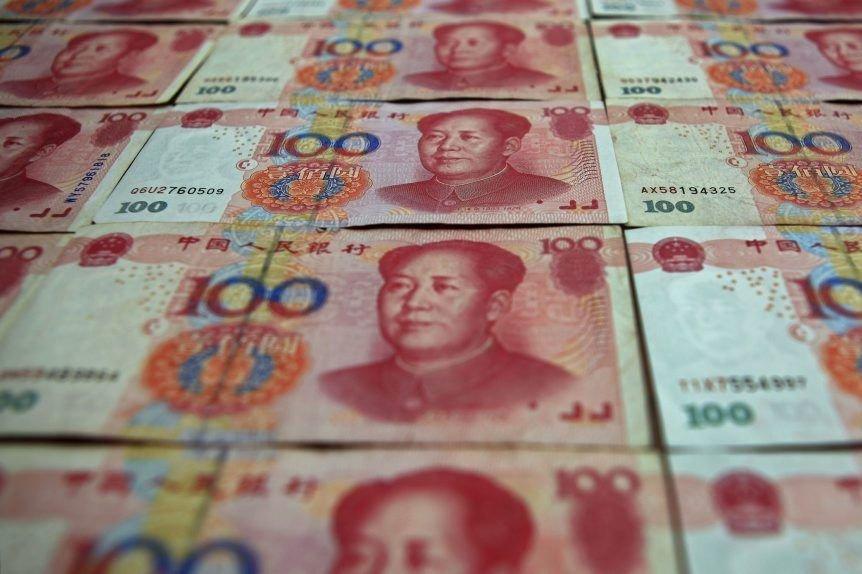 La monnaie chinoise reste cependant très loin derrière... (PHOTO PETAR KUJUNDZIC, REUTERS)