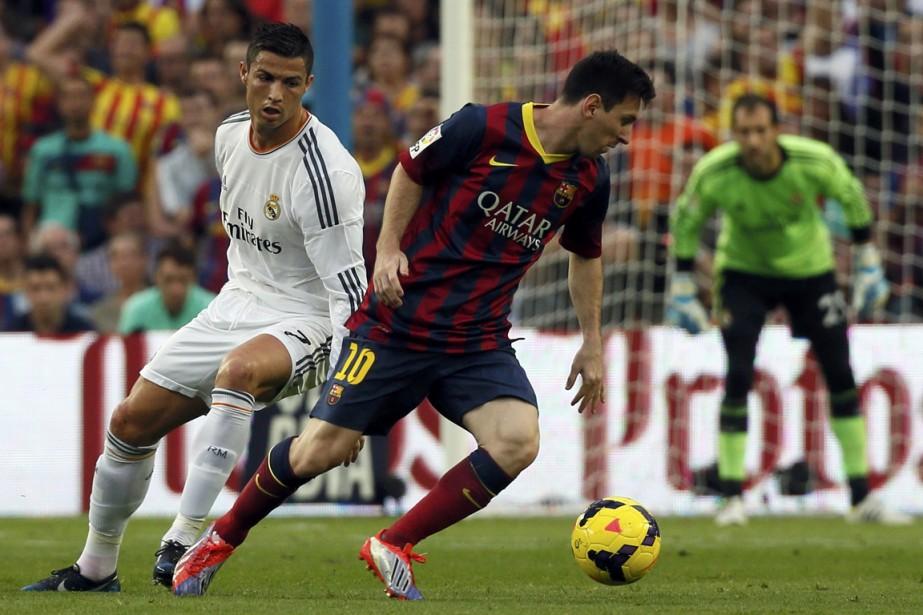 Cristiano Ronaldo et Lionel Messi... (Photo Gustau Nacarino, Reuters)