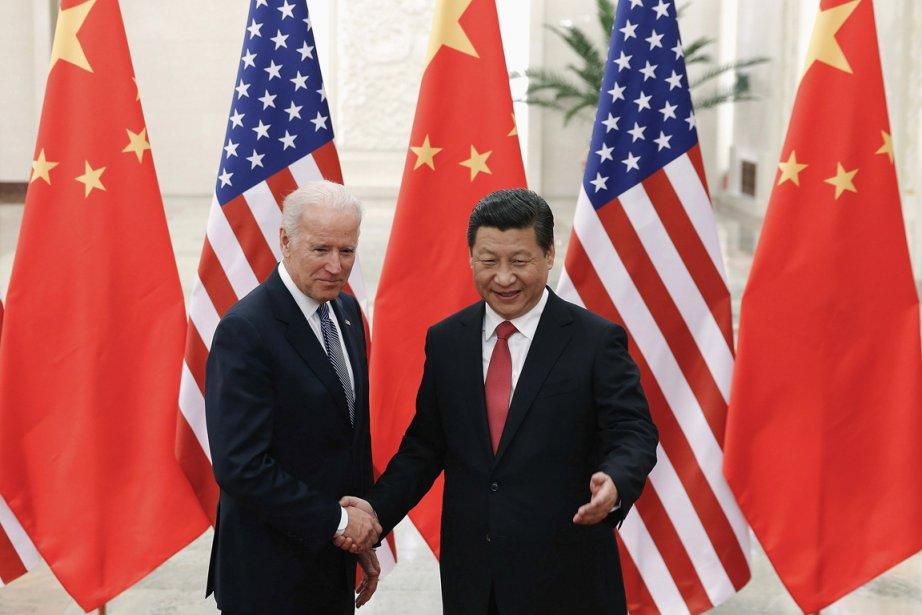 Le vice-président américain Joe Biden e compagnie du... (PHOTO LINTAO ZHANG, AFP)