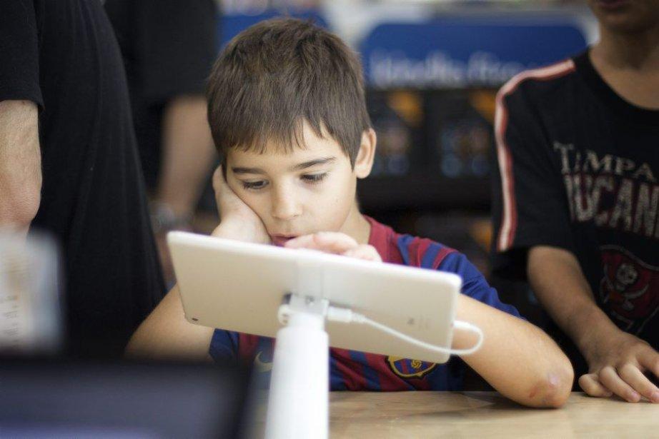 L'utilisation d'une tablette électronique iPad semble... (Photo archives AP)