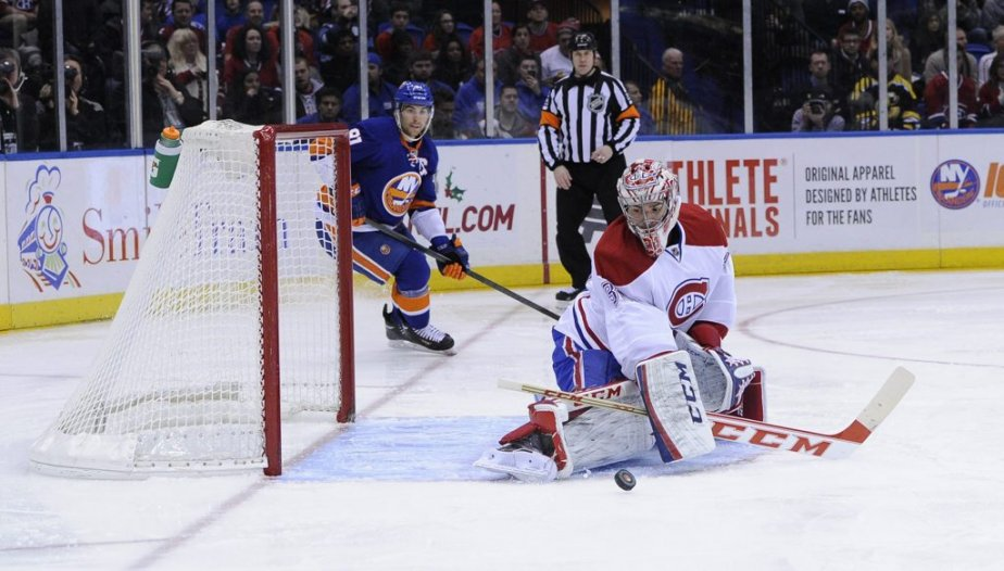 Carey Price du Canadien arrête un tir de John Tavares des Islanders lors de la deuxième période. | 14 décembre 2013