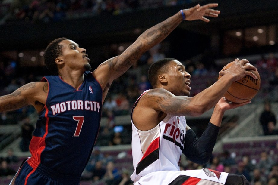 Brandon Jennings (7), des Pistons, tente d'empêcher Damian... (Photo Tim Fuller, USA Today)