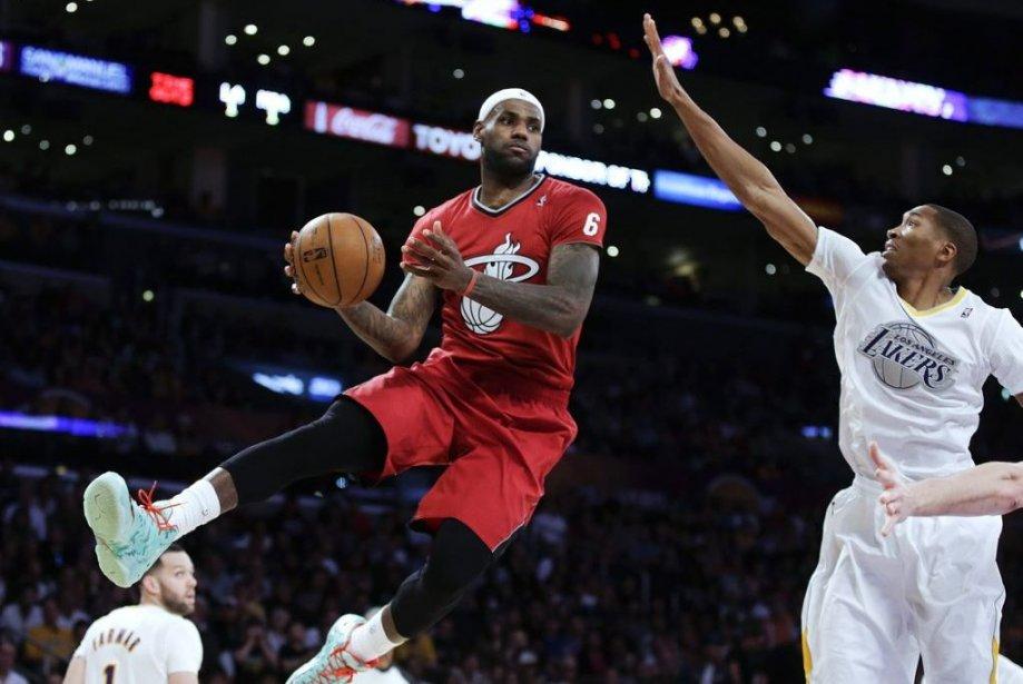 Miami, double tenant du titre en NBA, a signé une sixième victoire... (Photo AP)