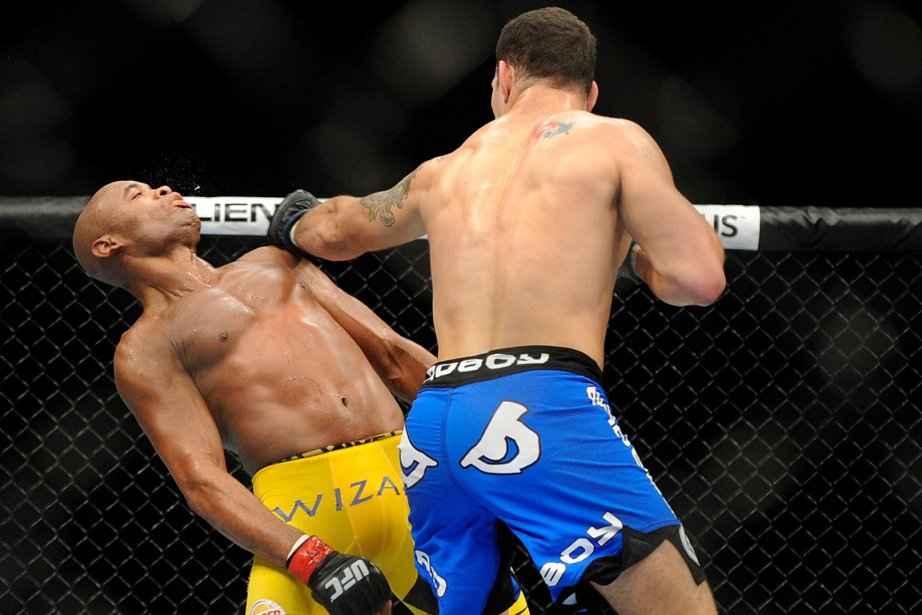 Anderson Silva et Chris Weidman... (Photo David Becker, archives AP)
