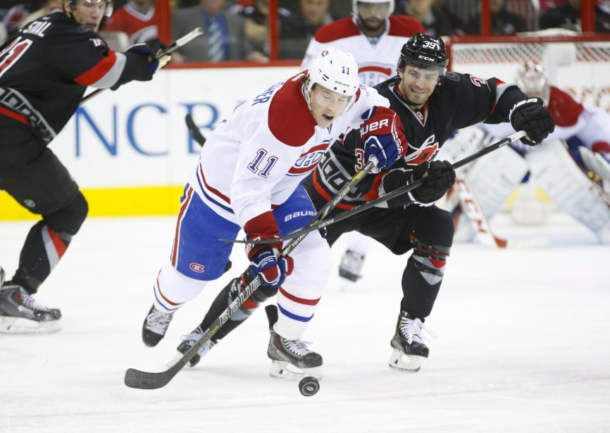 Brendan Gallagher tente de s'échapper avec la rondelle. (Photo James Guillory, USA TODAY Sports)