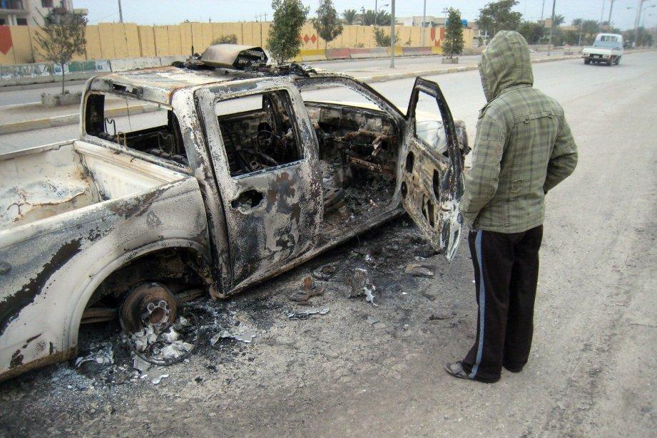 Un attentat à la bombe sur une voiture.... (Photo AP)
