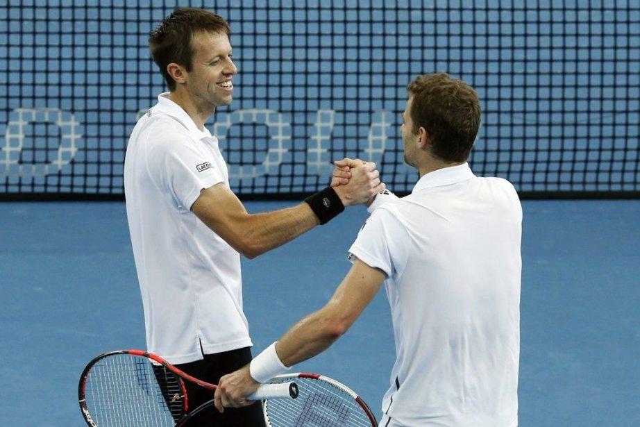 Le Canadien Daniel Nestor et son partenaire polonais... (PHOTO JASON REED, REUTERS)