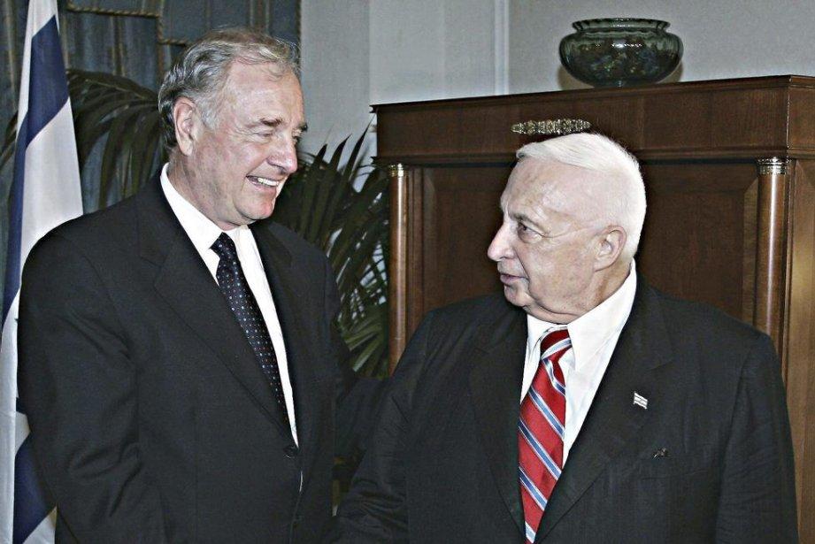Paul Martin et Ariel Sharon lors d'une rencontre... (La Presse Canadienne)
