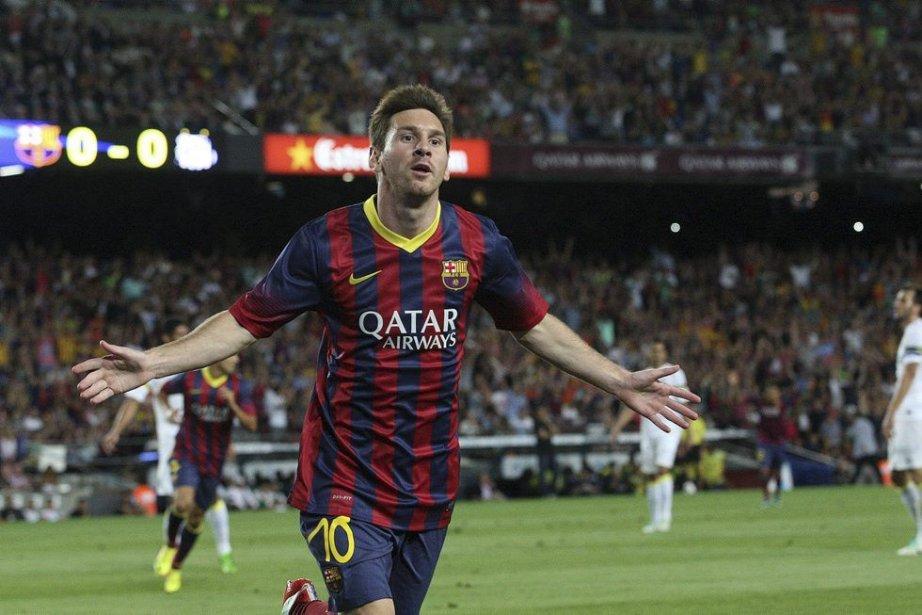 L'attaquant Lionel Messi est le quadruple récipiendaire du... (PHOTO JOSE JORDAN, ARCHIVES AFP)