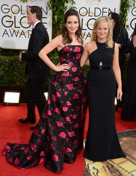 Les animatrices de la soirée Tina Fey et Amy Poehler. (Photo Jordan Strauss, AP)