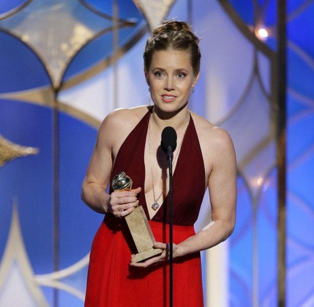 Amy Adams a remporté le prix de la meilleure actrice dans la catégorie «film musical ou comédie» pour American Hustle. (AP)