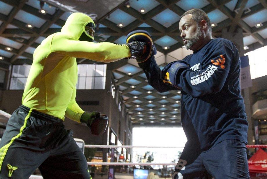 Jean Pascal en action dans le ring avec son entraîneur Marc Ramsay. (Photo Robert Skinner, La Presse)