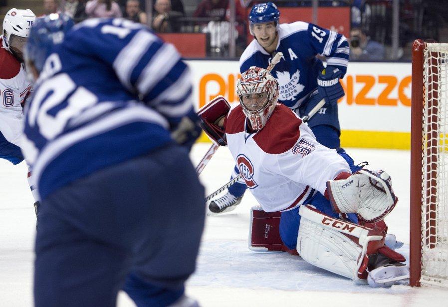 Carey Price a les yeux rivés sur la rondelle alors que Mason Raymond se prépare à tirer. (Photo Frank Gunn, La Presse Canadienne)