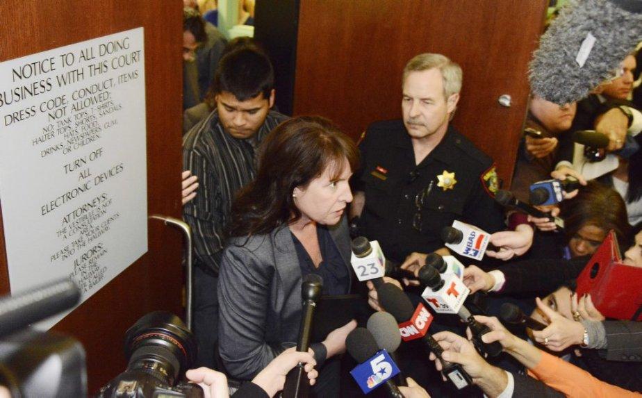 Erick Munoz (à gauche), le mari de la... (Photo AP)