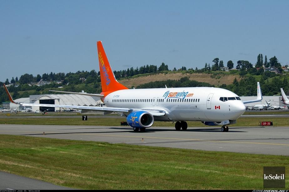 Un avion du transporteur canadien Sunwing qui... (Photothèque Le Soleil)