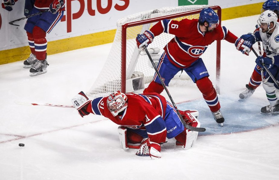 Carey Price et Douglas Murray en pleine action. (Photo Olivier Pontbriand, La Presse)
