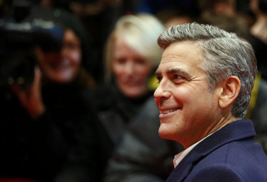 Samedi 8 février : George Clooney arrive sur le tapis rouge pour la présentation de son film «Monuments Men». (PHOTO THOMAS PETER, REUTERS)
