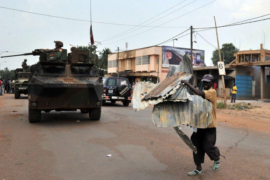 En fin de matinée, malgré les remontrances des... (Photo ISSOUF SANOGO, AFP)