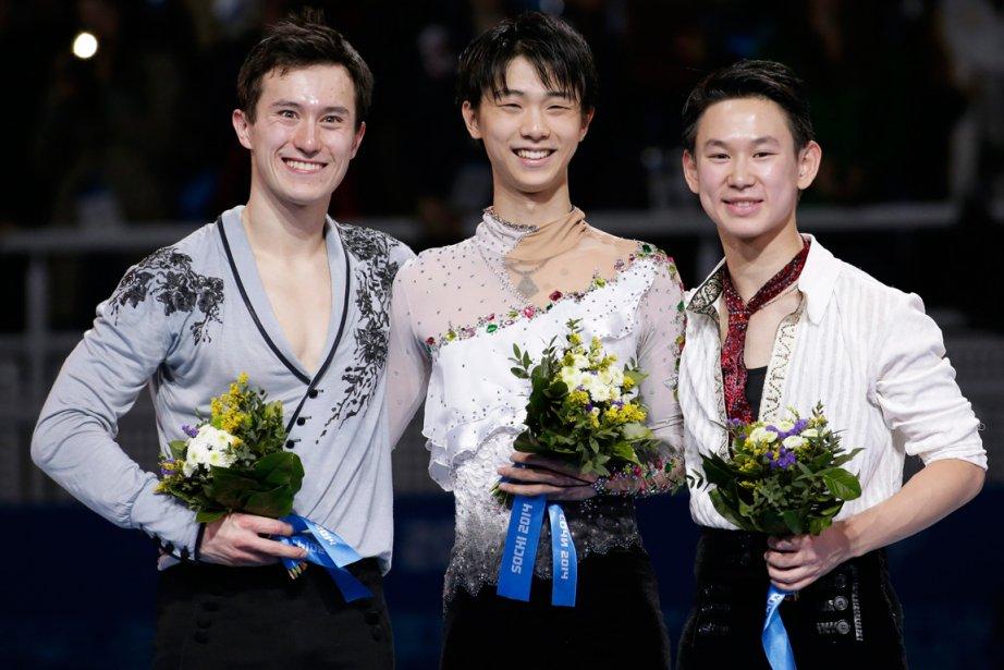 Le Canadien Patrick Chan, médaillé d'argent, le Japonais... (Photo Bernat Armangue, AP)