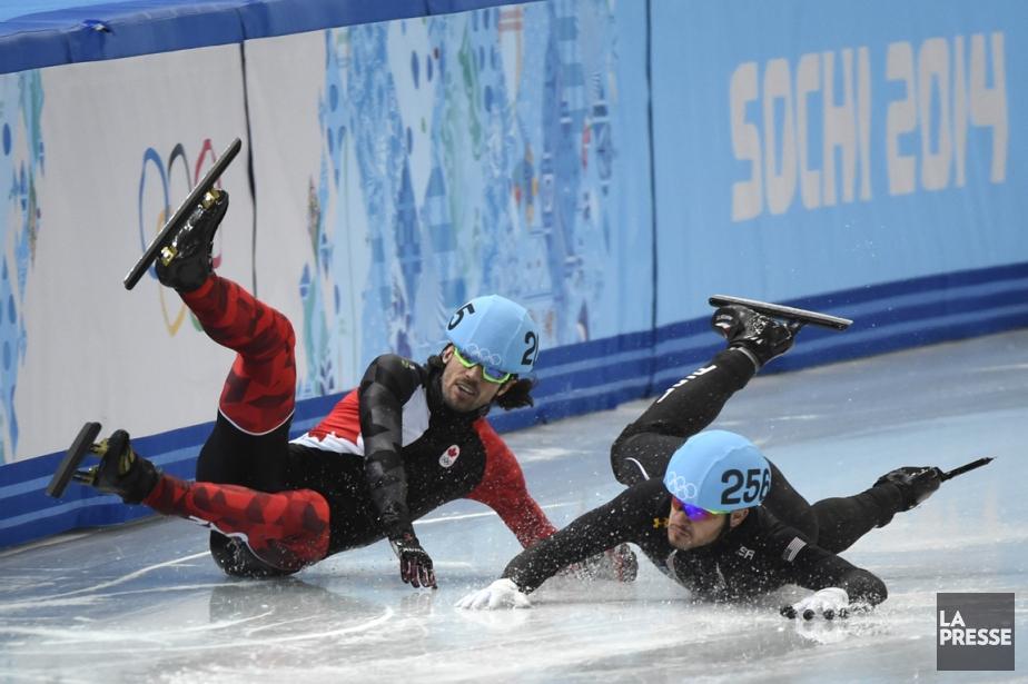 Charles Hamelin (à gauche) a chuté lors de... (Photo Bernard Brault, La Presse)