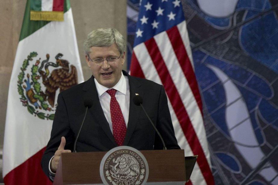 «Nous imposerons également des sanctions économiques au régime... (PHOTO YURI CORTEZ, AFP)