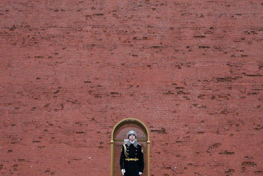 La police russe a interpellé dimanche quatre... (PHOTO MAXIM SHEMETOV, REUTERS)