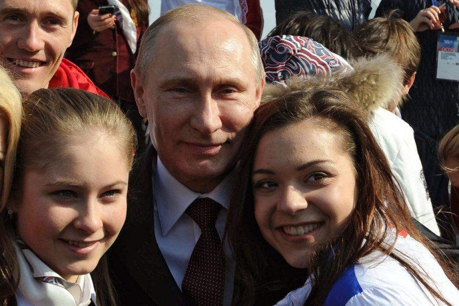 Le président russe Vladimir Poutine s'est fait prendre... (Photo Mikhail Klimentyev, AFP)