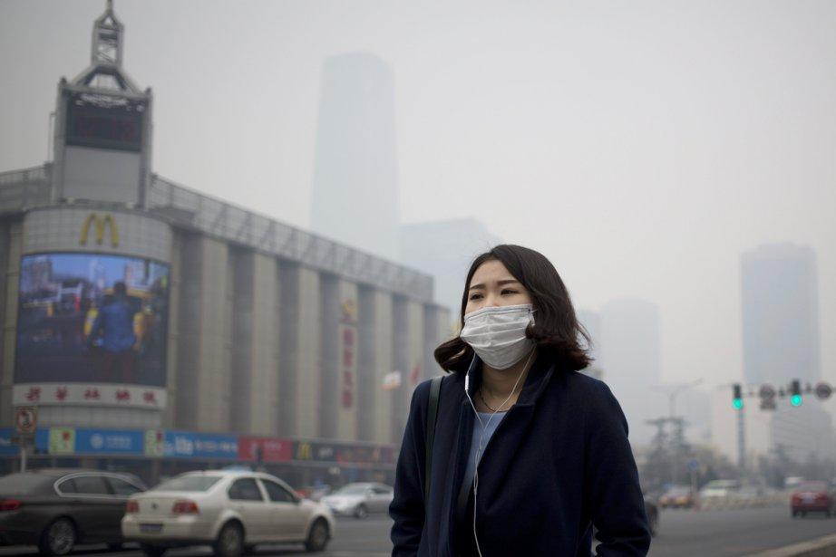 Pékin connaît d'importants problèmes de pollution atmosphérique, les... (PHOTO ANDY WONG, AP)