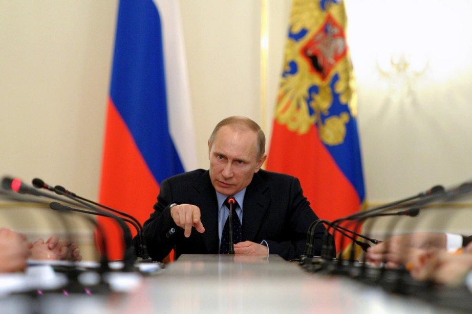Le président russe Vladimir Poutine a présidé hier... (PHOTO ALEXEY DRUZHININ, AFP/RIA-NOVOSTI)