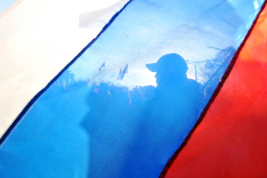 Des activistes pro-russes manifestent à Eupatoria, en Crimée,... (PHOTO GENYA SAVILOV, AFP)