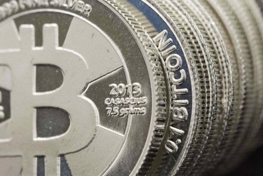 Le bitcoin très controversé, qui traverse une... (Photo Jim Urquhart, Reuters)
