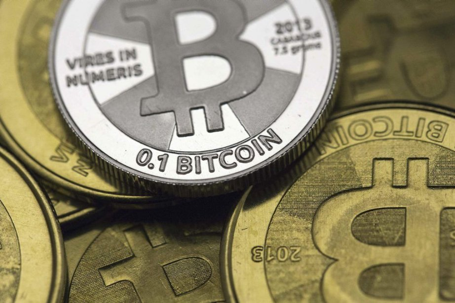 Selon l'agence, les plateformes d'échanges de bitcoin peuvent... (PHOTO JIM URQUHART, REUTERS)