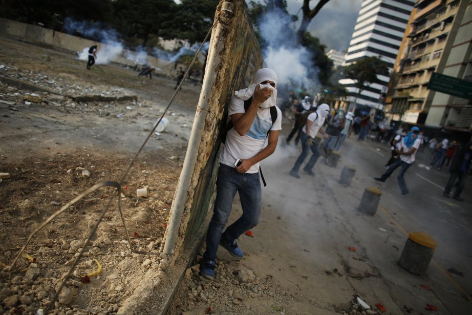À Caracas, des affrontements ont eu lieu quand... (Photo TOMAS BRAVO, Reuters)