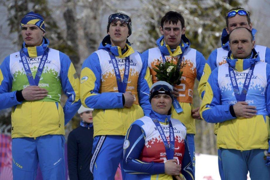 Les athlètes ukrainiens ont trouvé une autre manière... (PHOTO KIRILL KUDRYAVTSEV, AFP)